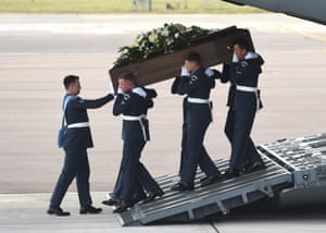 The coffin of Joel Richards is carried off a Royal Air Force C-17 military transporter plane at RAF Brize Norton.