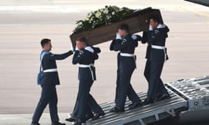 The coffin of Joel Richards is carried off a Royal Air Force C-17 military transporter plane at RAF Brize Norton on 1 July 2015.