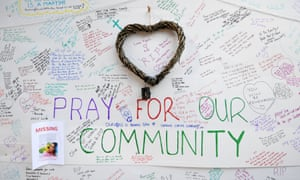 Messages of condolence are left at a relief centre close to Grenfell Tower.