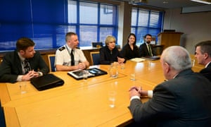 Theresa May meets officers from Police Scotland at Govan Police Station in Glasgow this morning.