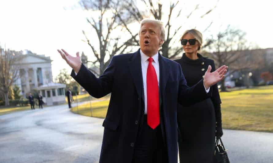 Donald Trump leaves the White House with his wife, Melania, to board Marine One ahead of the inauguration of President-elect Joe Biden on 20 January.