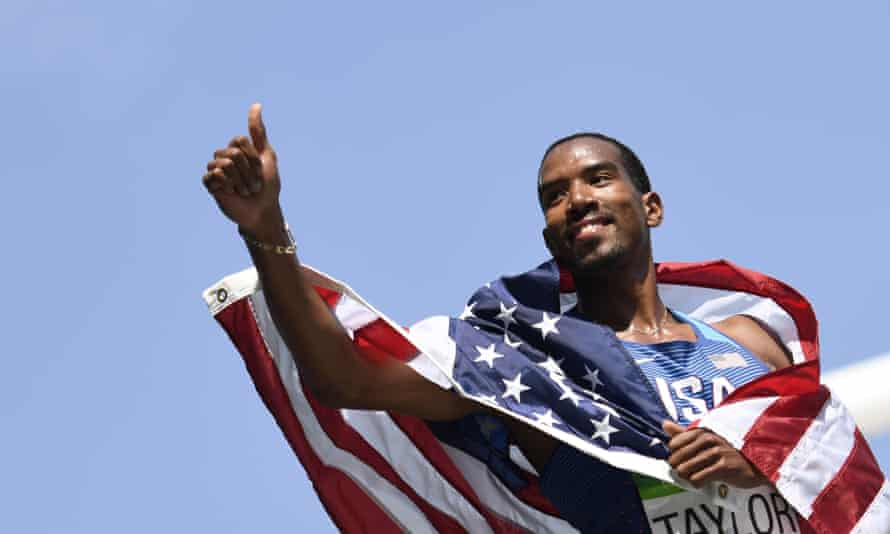 Christian Taylor celebrates with the American flag.