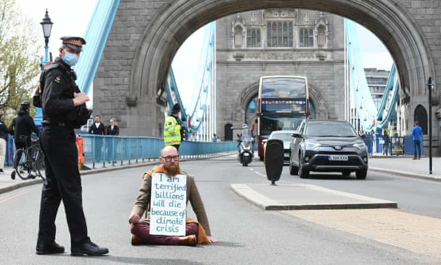 Morgan Trowland, 38, pictured blocking traffic on Tower Bridge in London.