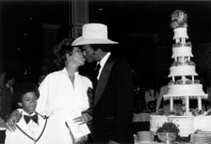 Kissing her new husband, actor Glynn Turman, as her son Kecalf Franklin looks on, at their wedding at her father's New Bethel Baptist Church in 1978 in Detroit, Michigan