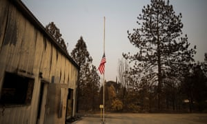 A flag at half mast in front of a burned firehouse outside of Redding. The Carr fire destroyed large swaths of the city and surrounding area.