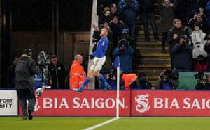 Vardy celebrates by the corner flag.