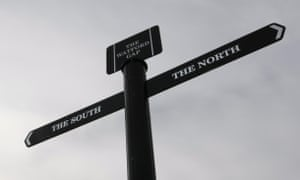 A signpost marking the directions of north and south at the Watford Gap on the M1