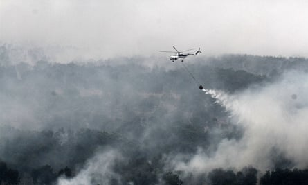 Helicoptering water on to Indonesia's forest fires