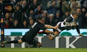 Barbarians' South African player Bryan Habana surges past the challenge of New Zealand's Mike Delany to score his third try.