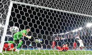 Turkey's defender Merih Demiral scores an own goal.