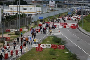 Passengers walk from the airport as protesters block the roads leading to Hong Kong International Airport, September 1, 2019.