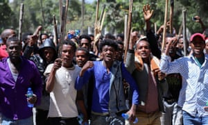 Oromo youth chant slogans during a protest in-front of activist Jawar Mohammed's house in Addis Ababa.