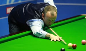 Mark Williams in the second round of the World Snooker Championship at the Crucible; he later went to hospital suffering chest pains.