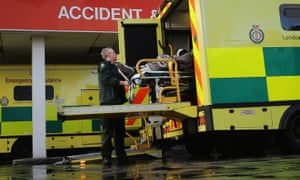 Patient is taken from ambulance outside A&E