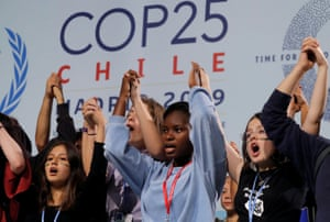 Climate change activist Greta Thunberg is seen on stage behind young activists during the COP25 last week.