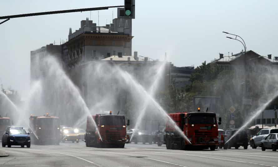 Trucks spray water in Sadovoye Koltso Street in Moscow to protect the road surface from overheating.
