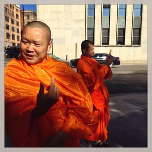 Somboon Rattanawerapong, 47, a buddhist monk from Thailand who lives in Arlington, Texas, visits the Texas School Book Depository and surrounding streets that mark the events where JFK was assassinated by Lee Harvey Oswald