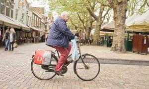 An older man cycling