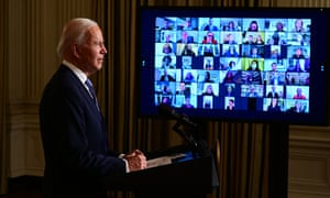 Joe Biden swears in presidential appointees during a virtual ceremony in the Oval Office.