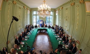 The French prime minister, Edouard Philippe, centre, and other ministers meet union representatives
