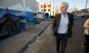 Philip Alston visits a homeless camp in Downtown LA. Alston said: 'The persistence of extreme poverty is a political choice made by those in power. With political will, it could readily be eliminated.'