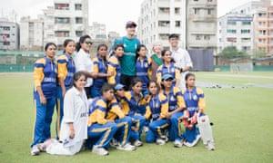 Team spirit: the Sreepur girls with England's Steven Finn.