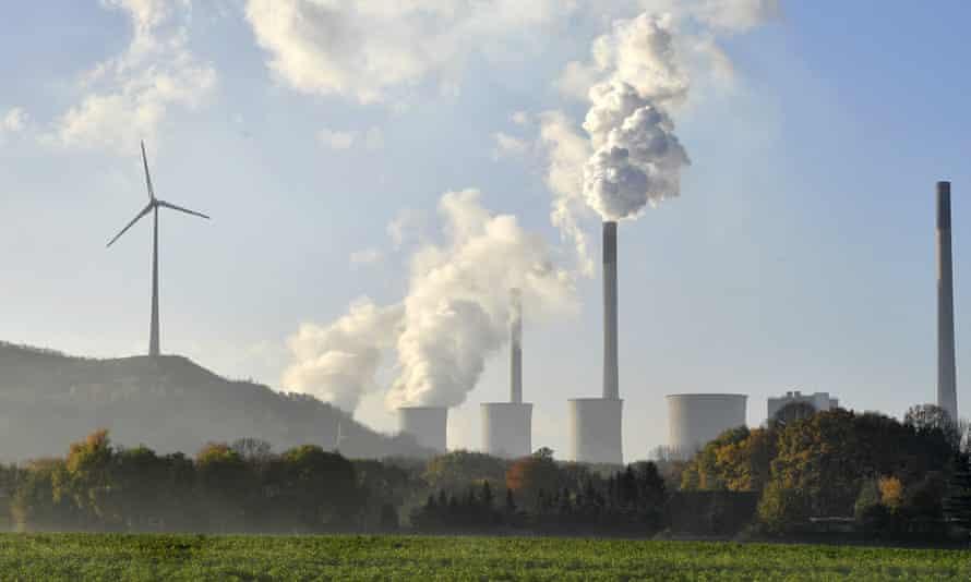 A coal-burning power plant near a wind turbine in Gelsenkirchen, Germany.