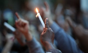 People holding candles at a vigil for the Grenfell Tower fire victims