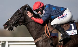Bryony Frost pats her horse Black Corton as they approach the winning post to claim victory in the Reynoldstown Novce Chase at Ascot in February.
