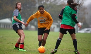 World Cup dreaming: girls playing football in Auckland. Australia and New Zealand have won the right to co-host the women's World Cup in 2023