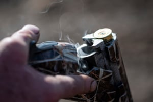 Smoke rises from the chamber of a shot gun after being fired
