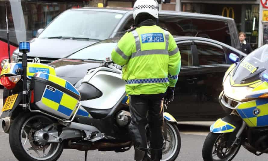 Met police officer with motorbike