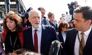 Jeremy Corbyn arrives at conference, flanked by Brighton councillor Nancy Platts.