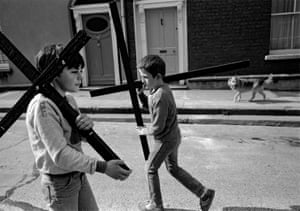 Good Friday, North Inner City, Dublin 1984The majority of the photographs were taken in Dublin and County Kerry, and depict a sense of community in the spectacles of religious processions and marches marking significant events of the recent past