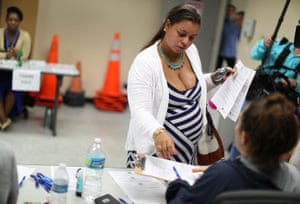 An expectant mother receives a free Zika test from a temporary clinic in Miami, Florida.