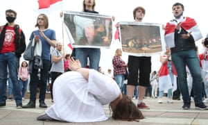 Demonstrators stage a performance criticising police brutality.