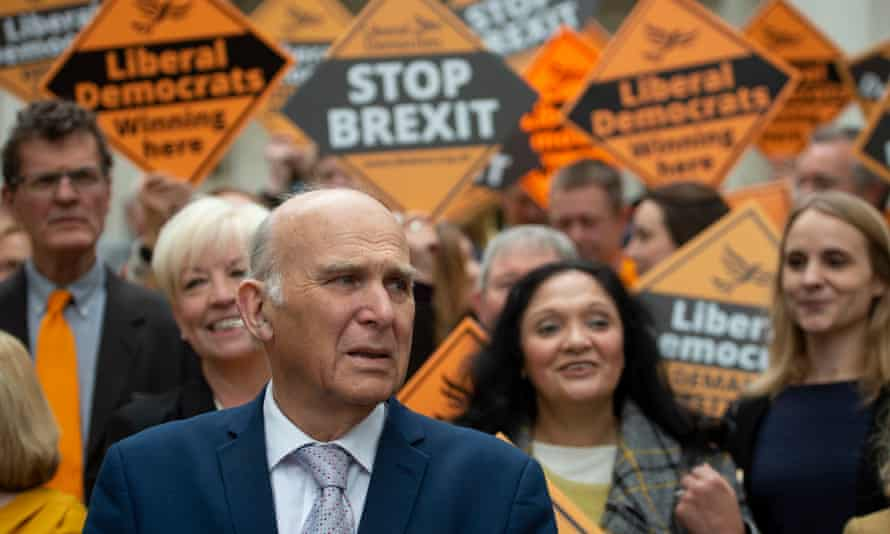 The Liberal Democrats leader, Vince Cable, with activists in Chelmsford.