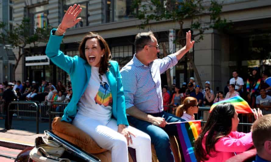 Kamala Harris waves to a cheering crowd during the San Francisco gay pride parade.