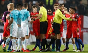 Jesse Lingard, right, looks agrieved as players from both sides clash as referee Deniz Aytekin intervenes.