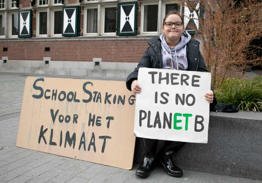 Young climate activist Lilly Platt in front of city hall in Zeist, the Netherlands,  where she does her weekly sit-in