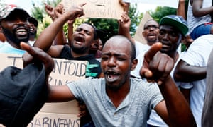 Protesters at a demonstration outside the Zimbabwean embassy.in Pretoria, South Africa