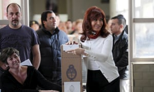 Argentina's outgoing president Cristina Fernandez de Kirchner casts her vote at a polling station on Sunday