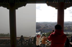 Visitors taking pictures at the top of the Jingshan Park overseeing the Forbidden City