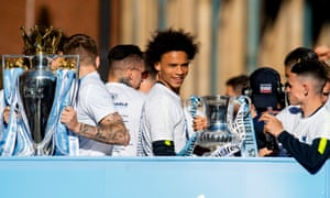 Leroy Sané enjoys Manchester City's open-top bus parade this month.