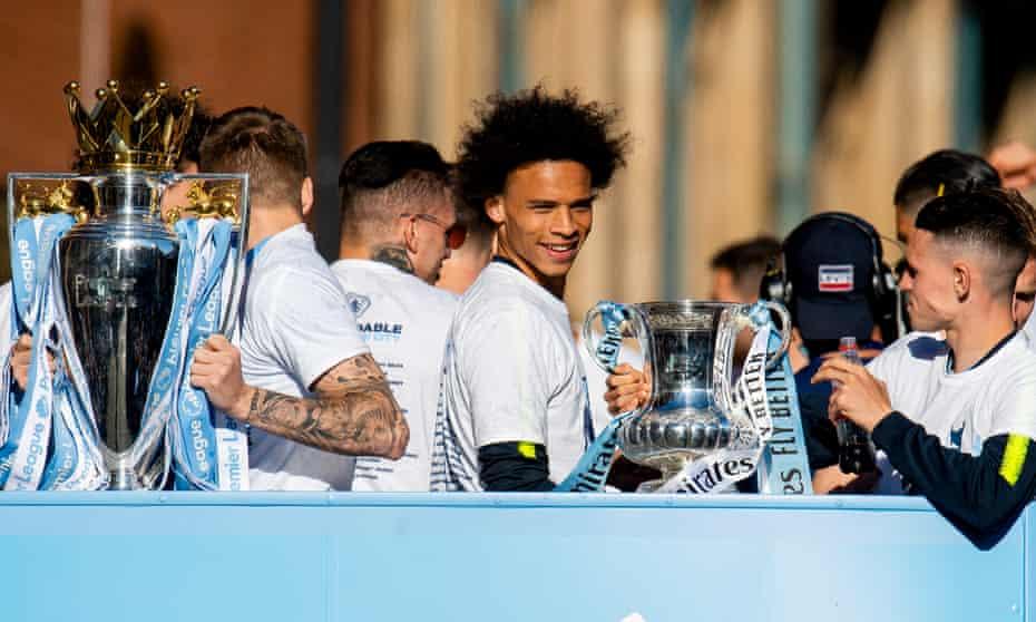 Leroy Sané enjoys Manchester City's open-top bus parade this month.