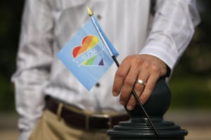 A man holds a rainbow flag in support of same-sex marriage outside the US supreme court
