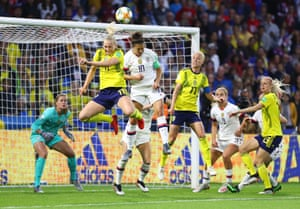 Carli Lloyd of the USA competes for a header with Stina Blackstenius of Sweden.