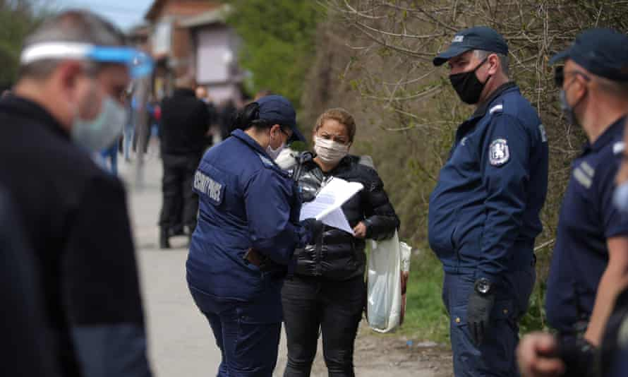 Police check a woman's papers in the largest Roma neighbourhood of Sofia, Bulgaria