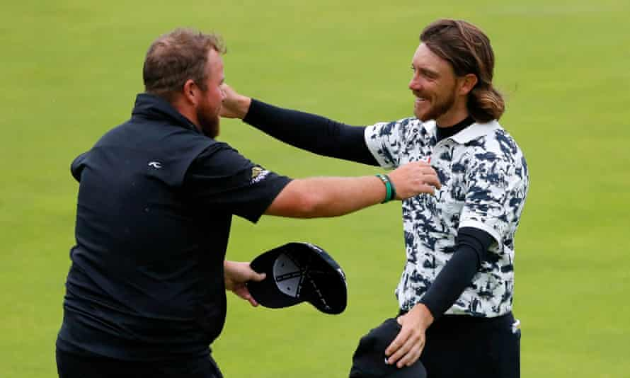 Shane Lowry hugs Tommy Fleetwood after the Irishman's victory was confirmed.