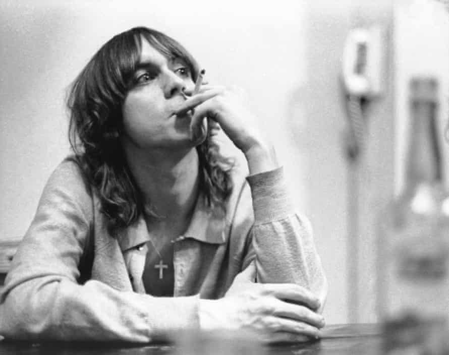 Iggy Pop smoking a cigarette at the MC5 house in 1968 in Ann Arbor, Michigan.